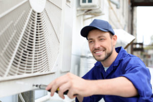 Technician maintains HVAC unit
