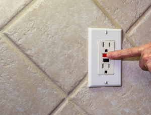 Outlets in the kitchen, bath, garage, basement, or other wet locations should be GFCI equipped