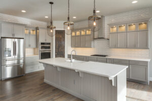Image shows kitchen island with electrical outlet on side