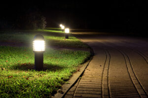 Sidewalk with outdoor lights illuminating for style and safety