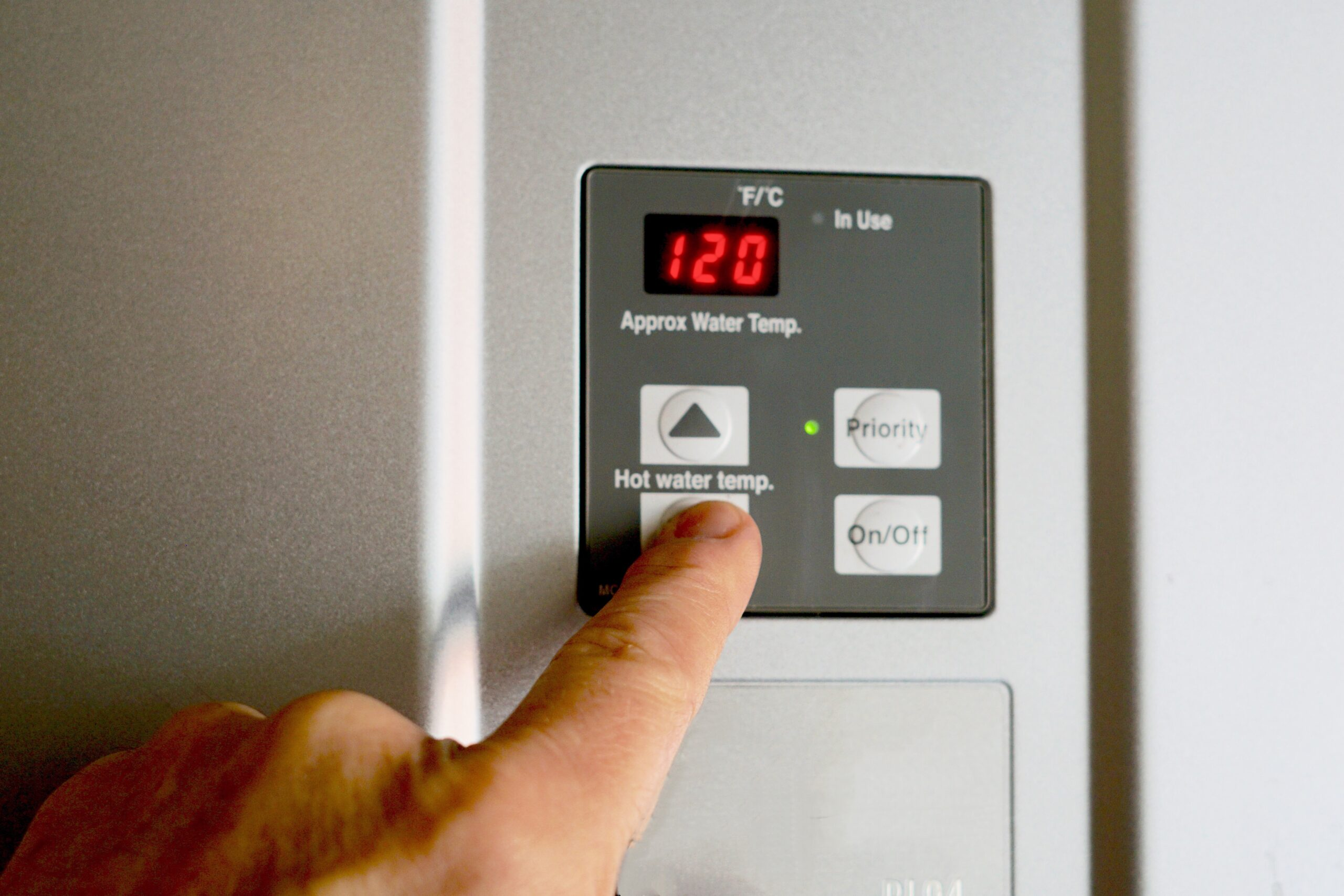 finger-on-hot-water-heater-control-unit-FKNWETA